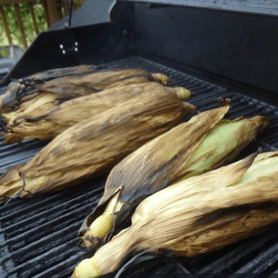 corn on the cob on the grill in the husk