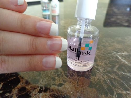 finger nails with French manicure polish
