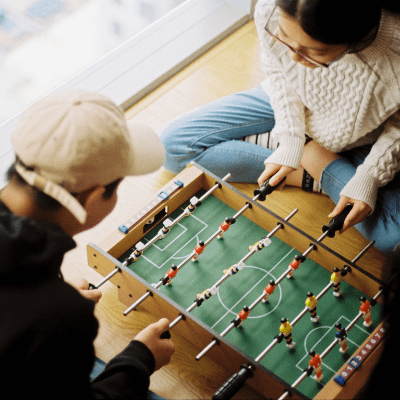 couple playing mini foosball
